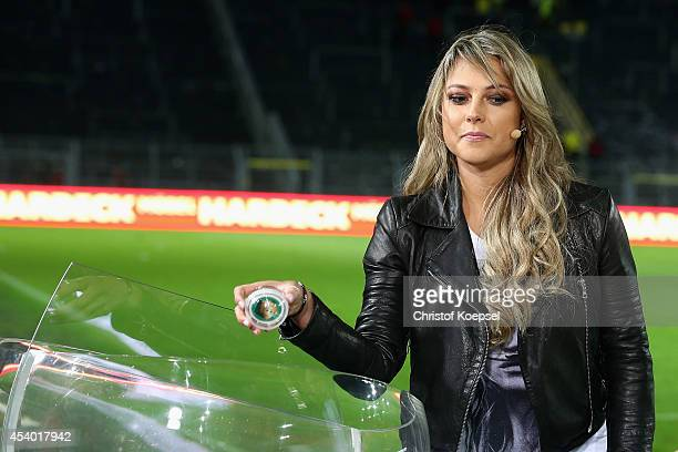 Moderator Vanessa Huppenkothen draws the matches for the second round of the german Cup after the Bundesliga match between Borussia Dortmund and...