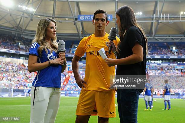 Moderator Vanessa Huppenkothen of Sport 1 television channel and field reporter Laura Wontorra of Sport 1 television interview Roque Santa Cruz of...