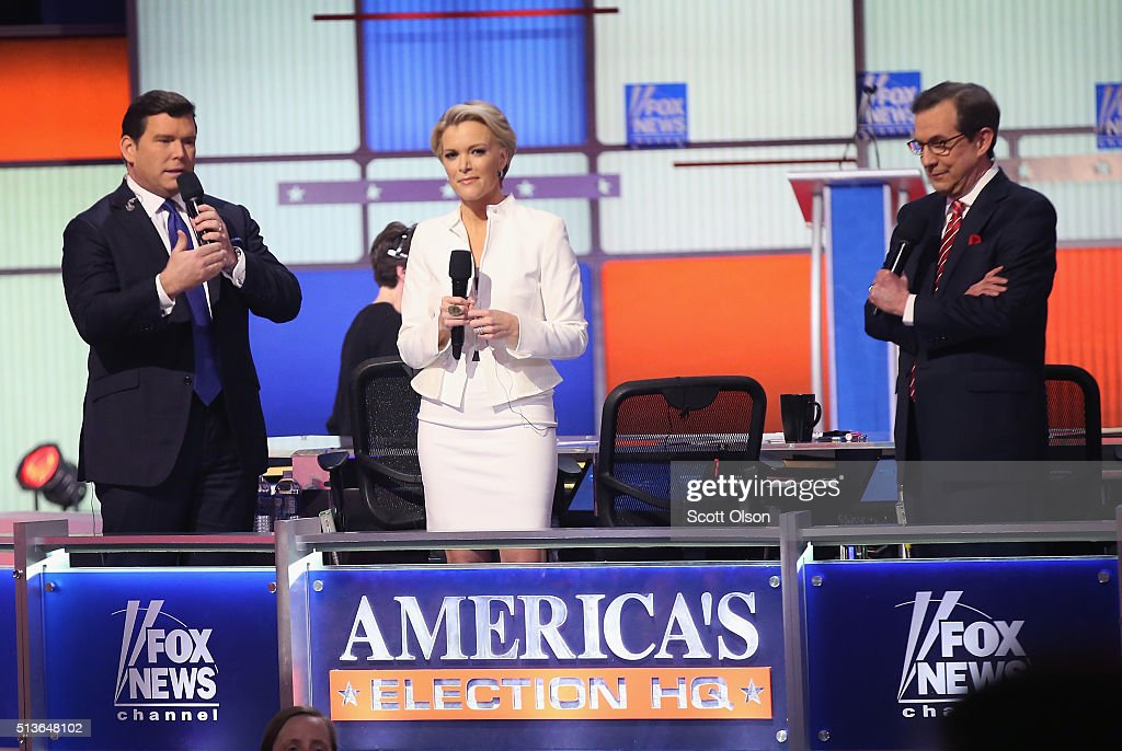 Moderators Bret Baier Megyn Kelly and Chris Wallace are introduced at the Republican presidential debate sponsored by Fox News at the Fox Theatre on...