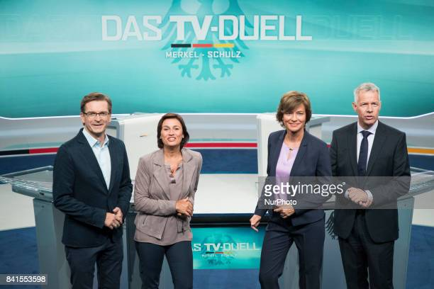 TV Moderators Claus Strunz Sandra Maischberger Maybrit Illner and Peter Kloeppel pose for a picture during a press preview of the TVDebate between...