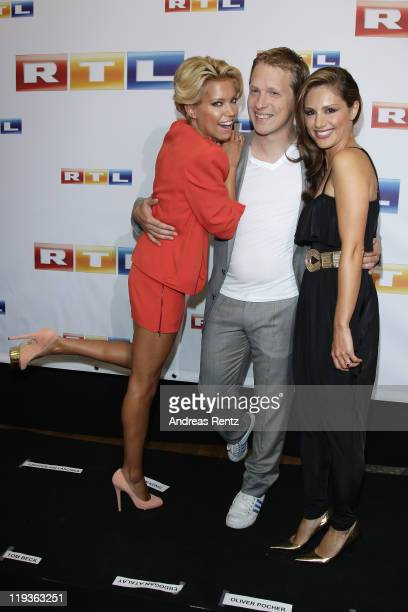 Moderator's Sylvie van der Vaart Oliver Pocher and Nazan Eckes attend the RTL Programm press conference Season 2011/2012 on July 19 2011 in Cologne...