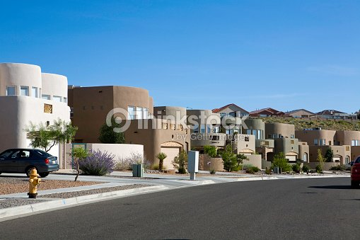 Modern adobe homes in a neighborhood stock photo thinkstock for Modern adobe houses