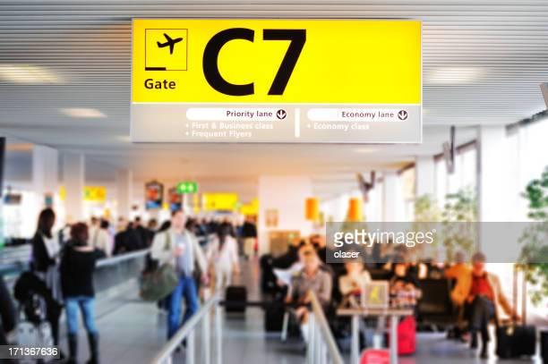 Modern airport terminal, travellers waiting