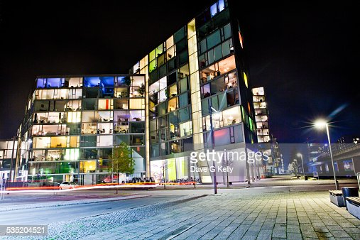 Apartment Building With Lights Forming Peace At Night Stock Photo