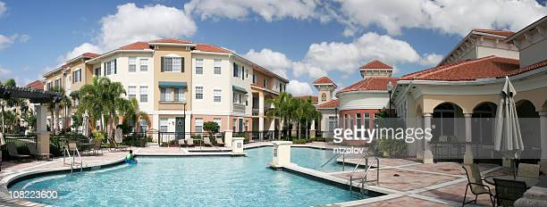 Modern apartment complex with pool and patio areas