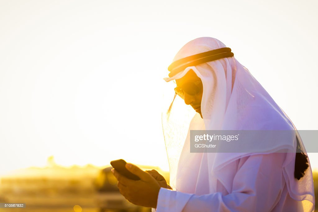 Modern Arab working on his smartphone