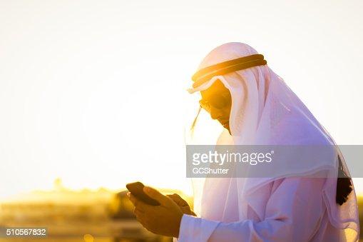 Modern Arab working on his smartphone