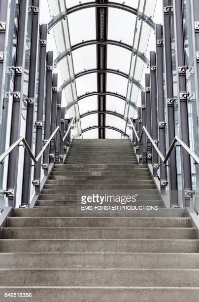 modern architecture tunnel, steps and staircase gate - moving upwards