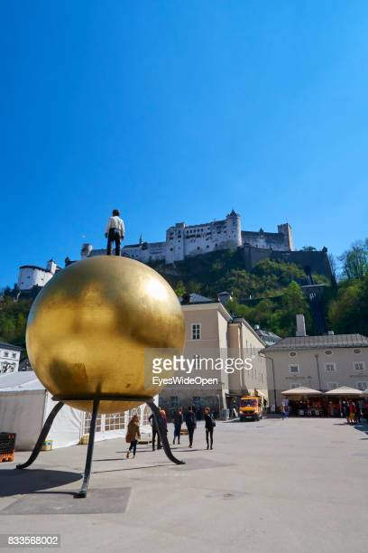 Modern art and the fortress Hohensalzburg castle in the historic center on April 19 2015 in Salzburg Austria