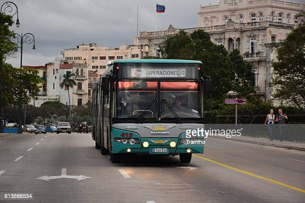 Modern articulated bus on the street in Havana