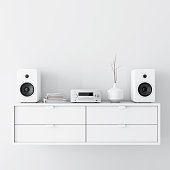 Modern audio stereo system with white speakers on bureau in modern interior, 3d rendering