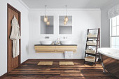 Interior of a contemporary bathroom with washstand and bathtube.