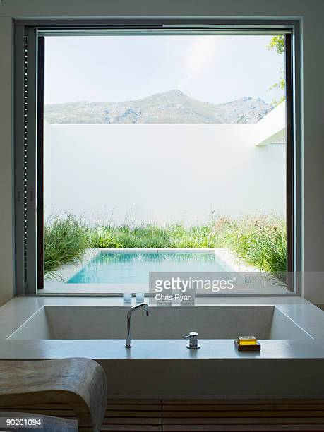 Modern bathroom looking out large window