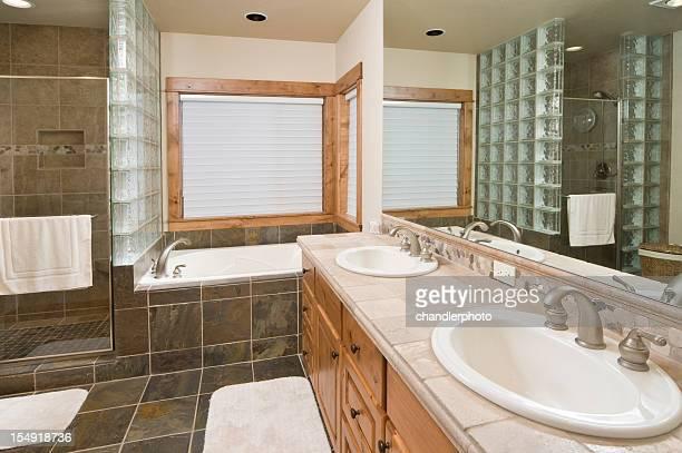 Modern bathroom with tile shower and floor
