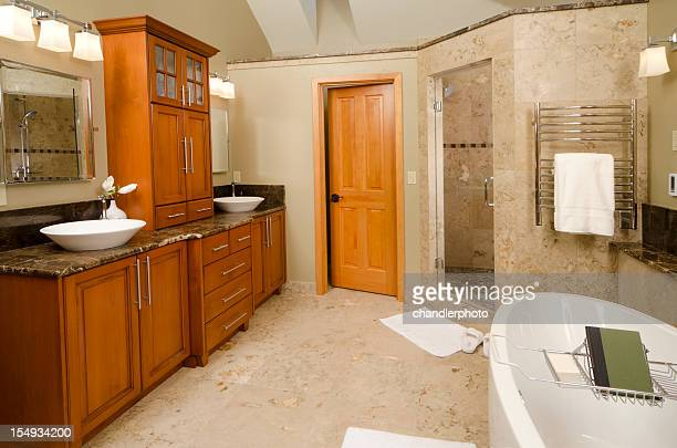 Modern bathroom with tile shower and floor