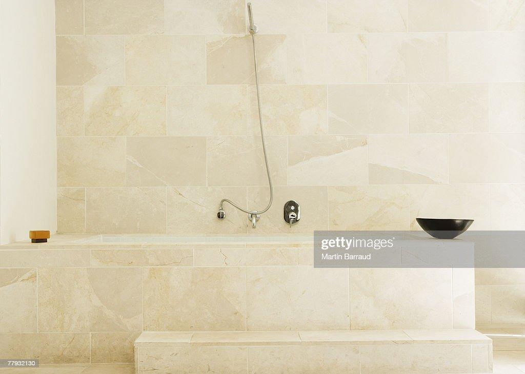 Modern bathtub with shower : Stock Photo