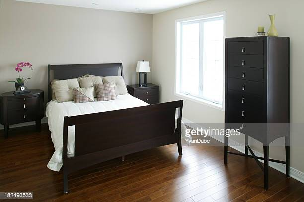 Modern bedroom with brown furniture