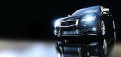 Modern black metallic sedan car in spotlight, banner composition. Generic desing, brandless. 3D rendering.