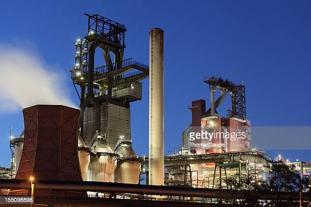 Modern blast furnaces at dusk