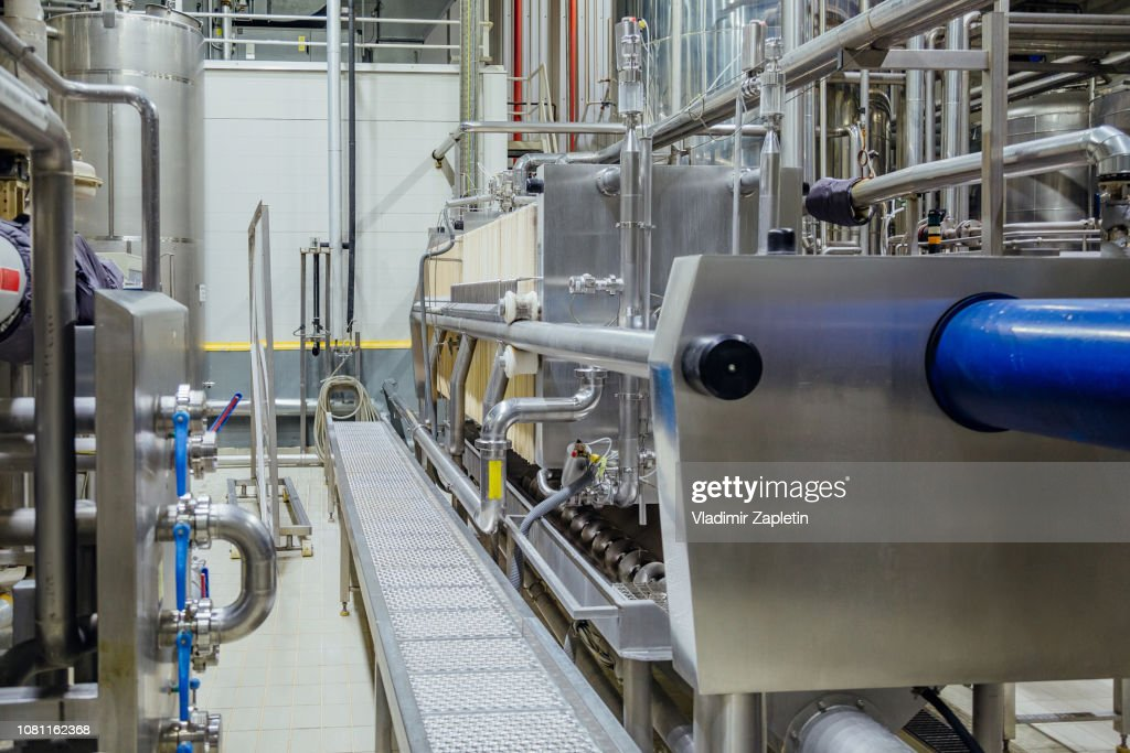 Modern Brewery Interior. Equipment Of Beer Production Line : Stock Photo