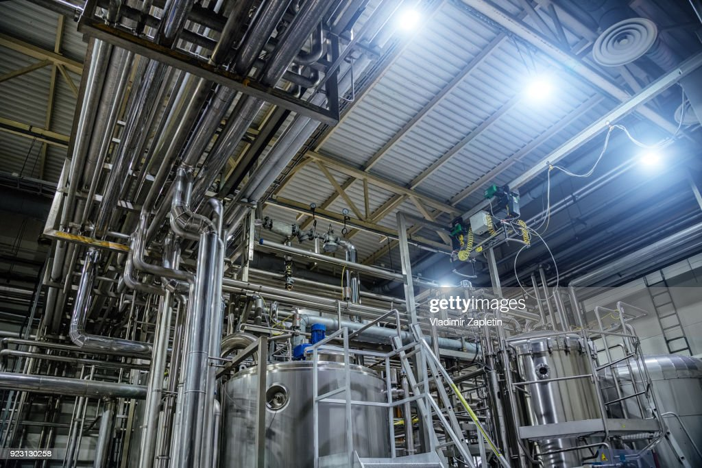 Modern Brewery Interior. Vats, Pipeline, Valves And Other Equipment Of Beer  Production Line