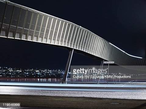 Modern bridge and city skyline at night : Stock Photo