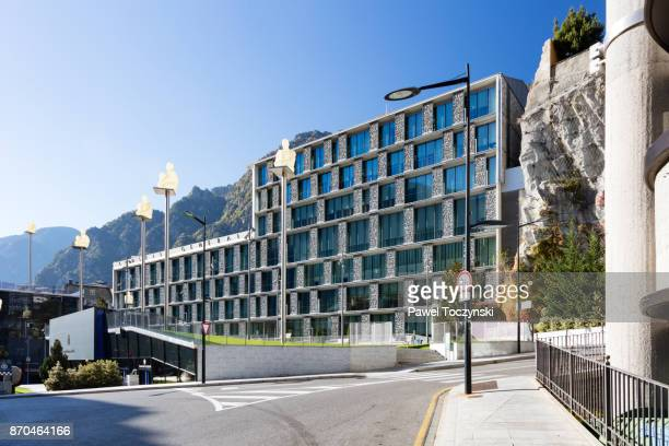 Modern building of the General Council of Andorra with Jaume Plensa sculptures