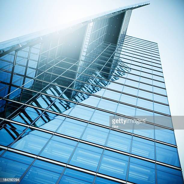 Modern building with a glass facade in sunlight