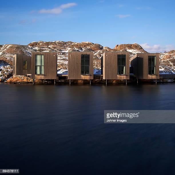 Modern buildings on rocky coast