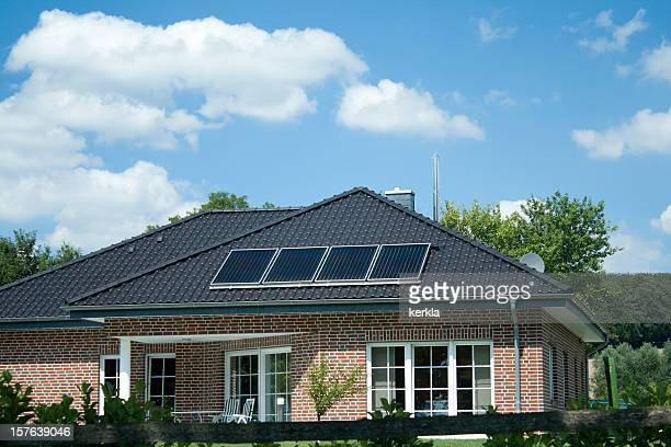 Modern bungalow with 4 small solar panels on roof
