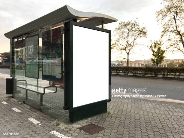 Modern bus stop with billboard