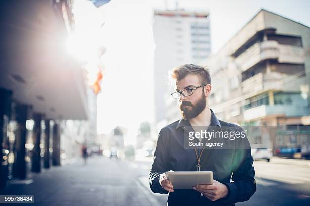Modern businessman with tablet