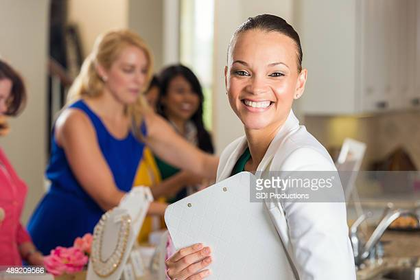 Modern businesswoman hosting direct sales party at home