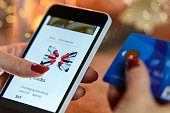 Modern Woman makes Christmas shopping via smartphone and a credit card in the e-store
