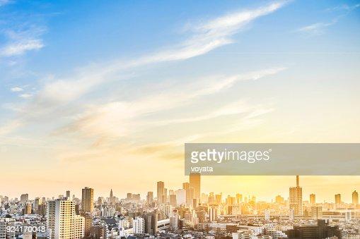 modern city skyline aerial view of shinjuku area with shinkansen railway under sunset sky in Tokyo, Japan : Stock Photo