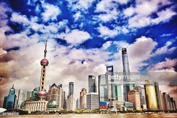Modern City Skyline With Oriental Pearl Tower Against Sky