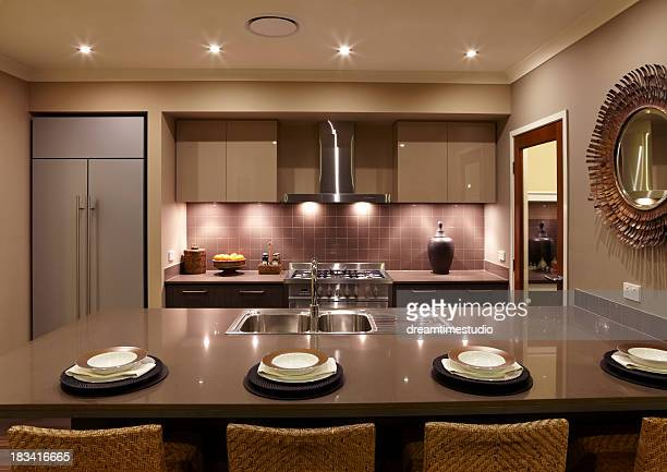 Modern coffee colored kitchen with four place settings