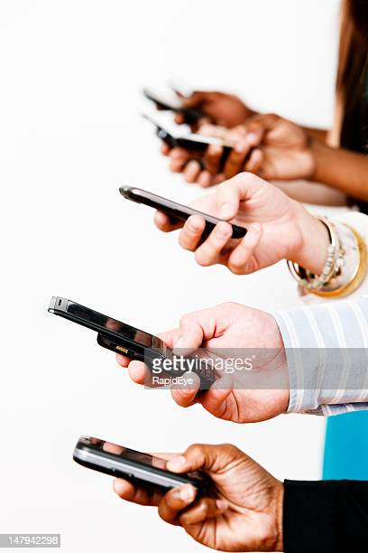 Modern communication: many hands texting on mobile phones