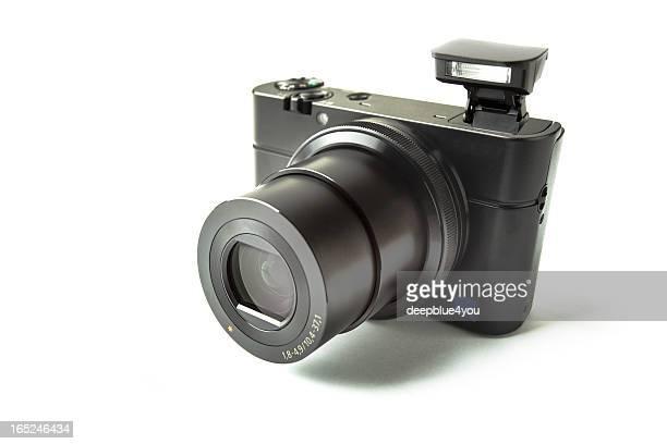 Modern compact camera on white