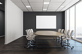 Modern conference room interior with empty poster on wall. Presentation concept. Mock up, 3D Rendering