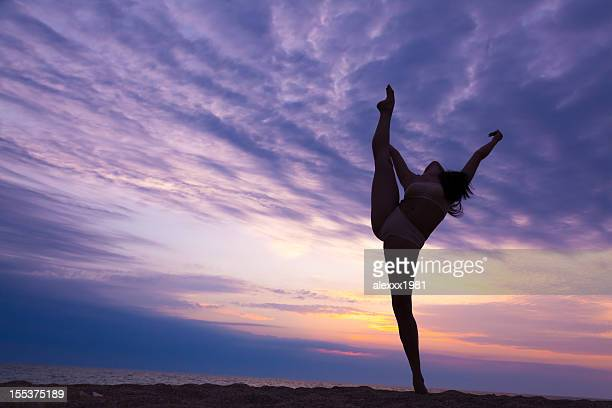 Modern contemporary dance young gymnast woman at sunset beach