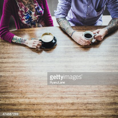 Modern Couple At Coffee Shop