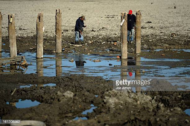 Modern day prospectors dig sift and muck near an old pier in the drained bottom of Berkeley Lake in northwest Denver Joe Amon The Denver Post