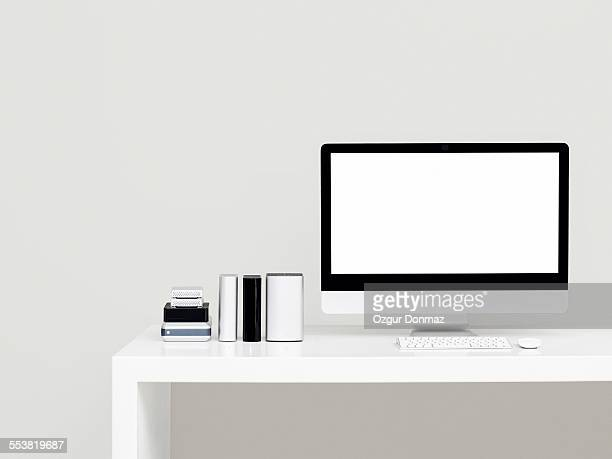 Modern desk with computer and hard drives