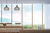 Modern dining room with mountain view 3d rendering Image.Decorate room with wood. There are large window overlooking the surrounding nature and mountains
