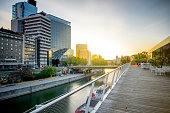 Modern district with contemporary buildings near the water channel in Vienna in the morning
