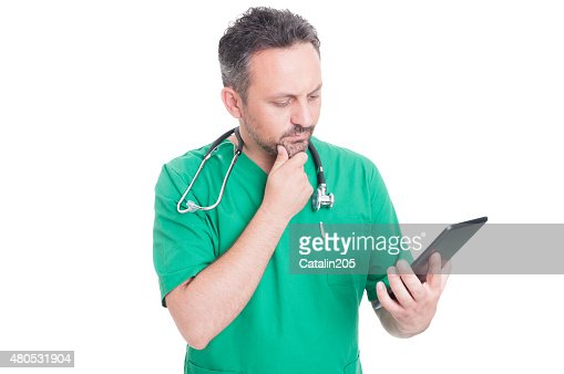 Modern doctor using wireless tablet : Stockfoto