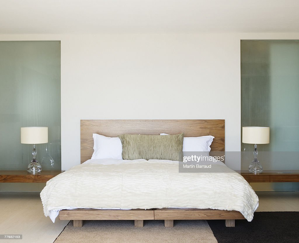 Modern double bed with bedside tables : Stock Photo