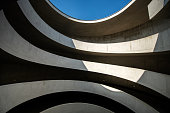 Leipzig, Germany: A modern driveway in a parking garage with a lot of curves.