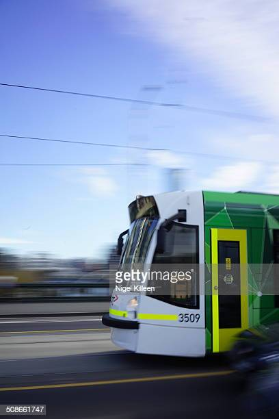 Modern electric tram One of Melbourne's electric trams traveling at speed Melbourne Australia